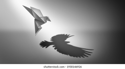 Vision and ambition as a business symbol for leadership power and success metaphor for growth as an origami paper bird casting a shadow of powerful real wings in a 3D illustration style.