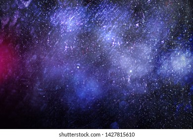 The visual effect of dust. Spots and reflexes on a black background. Space Nebula. Dirty lenses. Scratches on the glass. Blurred space. Light effect. Abstract background. Digital raster image.