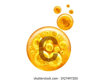 Vitamin C capsule. Golden balls with bubbles isolated on white background. Healthy lifestyle concept.