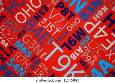 vivid colors of random postal letter and number patterns