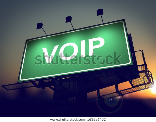 VOIP - Green Billboard on the Rising Sun Background.