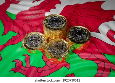 Wales Money Funding, British Pound Coins with Welsh Flag. 3D Illustration