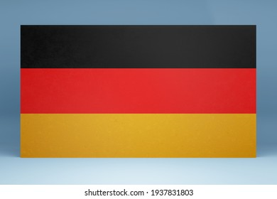 Wall with the colors black, red, yellow of the Germany flag in front of a bluish Background. Your own text or information can be added.  3D Illustration