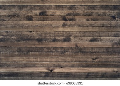 Wall of old wooden plank boards. Wooden material texture surface.