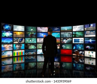 Wall of tv screens with a viewer. Digital Art gallery. 3D rendering