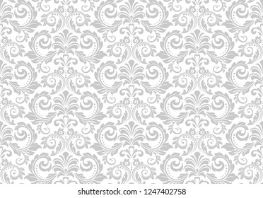 Wallpaper in the style of Baroque. Seamless background. White and grey floral ornament. Graphic pattern for fabric, wallpaper, packaging. Ornate Damask flower ornament.