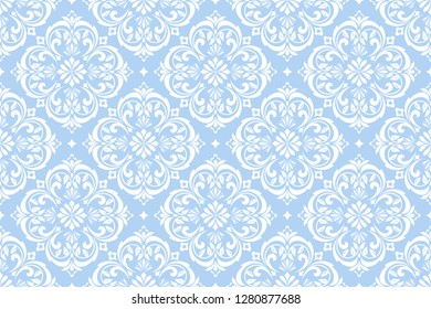 Wallpaper in the style of Baroque. Seamless background. White and blue floral ornament. Graphic pattern for fabric, wallpaper, packaging. Ornate Damask flower ornament
