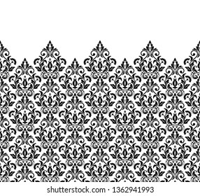 Wallpaper in the style of Baroque. Seamless background. White and black floral ornament. Graphic pattern for fabric, wallpaper, packaging. Ornate Damask flower ornament