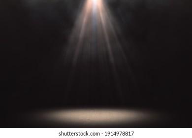 Warm spotlight background with smoke