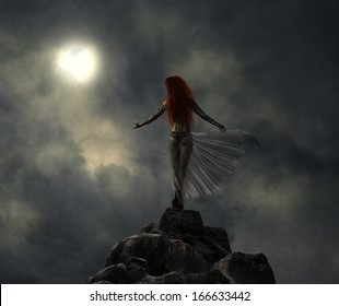 Warrior woman on the top of the hill in a stormy night