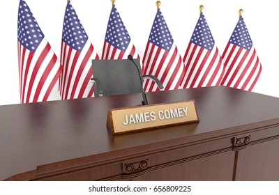 WASHINGTON - June 8, 2017: Wooden table with desk plaque JAMES COMEY and american flags in background. Former FBI Director James Comey testified before the Senate intelligence committee on June 8th.