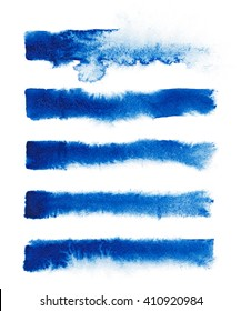 Watercolor. Blue abstract painted ink strokes set on watercolor paper.
