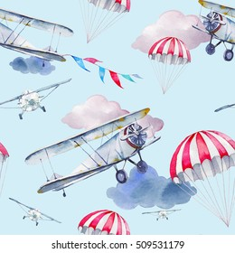 Watercolor cartoon aviation seamless pattern. Hand painted texture with vintage flying air planes, flags garlands, clouds and parachute on blue background. Repeating festive skydiving wallpaper