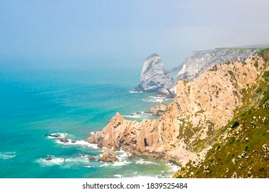 Watercolor drawing of Cape Roca Cabo da Roca with sharp rocks and cliffs on shores of Atlantic Ocean with copy space, Portugal