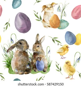 Watercolor easter pattern with rabbit and chick. Holiday ornament with bunny, bird, colored eggs and snowdrops isolated on white background. Nature illustration for design or fabric