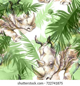 Watercolor exotic seamless pattern. Rhinoceros with colorful tropical leaves. African animals background. Wildlife art illustration. Can be printed on T-shirts, bags, posters, invitations, cards.