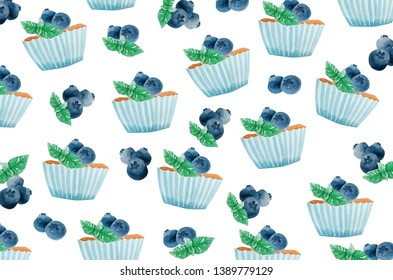 Watercolor hand painting of sweet blue cupcake with blueberry and pepermint leaf topping isolated on white background