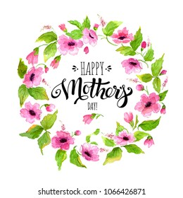 Watercolor holiday card Happy Mother's Day. Elegant lettering Happy Mother's Day in flower frame. Flower wreath with pink flowers around inscription.