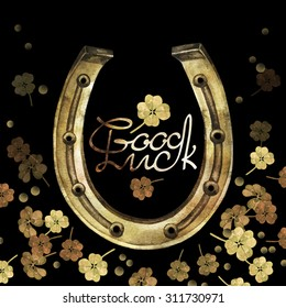 Watercolor horseshoes in golden color with clover design. Talisman for good luck. Design elements on black background. Decorations for Saint Patrick's Day