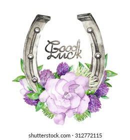 Watercolor horseshoes in silver color with violet floral design. Clover and gardenia. Talisman for good luck. Design elements isolated on white background. Decorations for Saint Patrick's Day