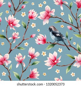 Watercolor magnolia and sakura flowers with green leaves and bird seamless pattern on a blue background.