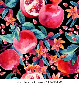 Watercolor pomegranate bloom branches and fruit seamless pattern. Pomegranate fruit, berries and flower on black background. Hand painted illustration