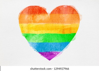 Watercolor rainbow flag in shape of heart, white background. Symbol of lgbt community, peace and pride