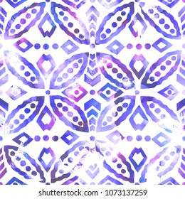 Watercolor seamless ethnic floral all over pattern. Traditional handmade oriental motif with circular and rhomboid shapes, shades of violet on white background. Textile design.