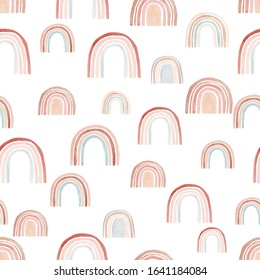 Watercolor seamless pattern with rainbows in warm pastel colors. Hand drawn cute abstract background, digital paper perfect for kids fabric textile and wrapping paper.