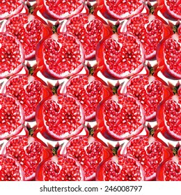 Watercolor seamless pattern with red pomegranates. Hand drawn red fruits on a white background