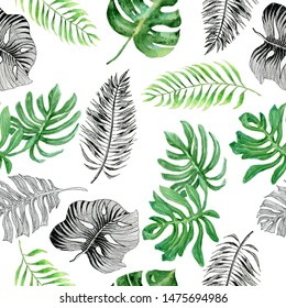 Watercolor seamless pattern with tropical plants. Beautiful allover print with hand drawn leaves of exotic plants. Botanical design on a white background.