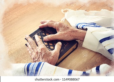 watercolor style and abstract image of Old Jewish man hands holding a Prayer book. Jewish traditional symbols