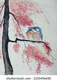 Watercolor with two beautiful kingfisher birds that sit on a flowering branch of sakura and catch midge. The illustration is made by hand, in traditional Chinese style.