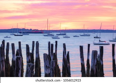 Waterfront view of pleasure boats and freighter beyond rotting wharf pilings in Portland, Maine, USA, at sunrise, with digital oil-painting effect, for coastal, nautical, and travel themes