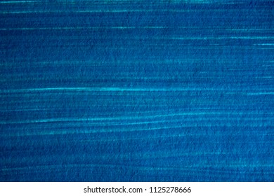 water-soluble texture. Background is gouache painted paper. Color paint strokes. Daub gouache, watercolor using white. Blue background