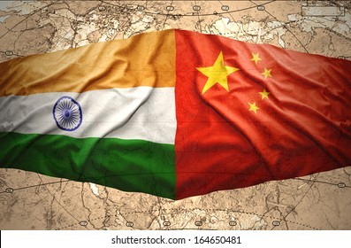 Waving Chinese and Indian flags on the background of the political map of the world
