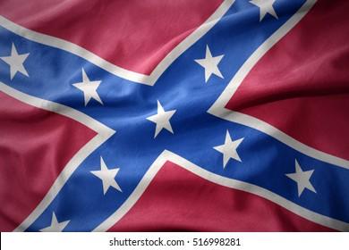 waving colorful confederate flag . Navy jack.