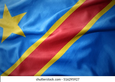 waving colorful national flag of democratic republic of the congo.