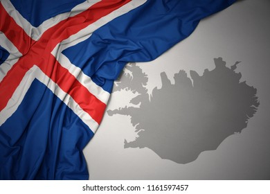 waving colorful national flag of iceland on a gray map background.3D illustration