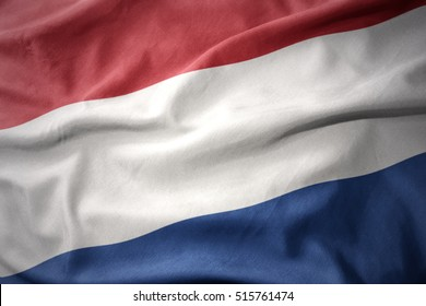 waving colorful national flag of netherlands.