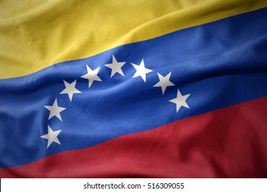 waving colorful national flag of venezuela.