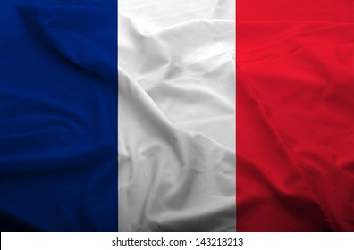 Waving flag of France. Flag has real fabric texture.