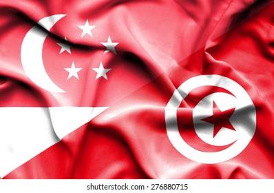 Waving flag of Tunisia and Singapore