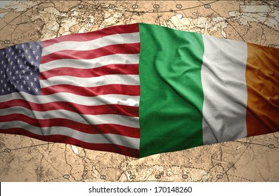Waving Irish and American flags of the political map of the world