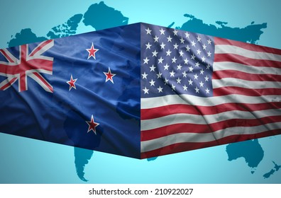 Waving New Zealand and American flags of the political map of the world