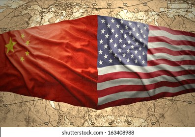 Waving United States of America and Chinese flags on the background of the political map of the world