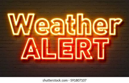 Weather alert neon sign on brick wall background