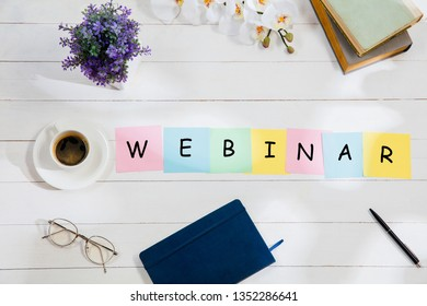 WEBINAR. Message at colorful note papers on a desk background. Lifestyle, business, office, motivation, plan, success, goal and management concept. Top or flat lay view.