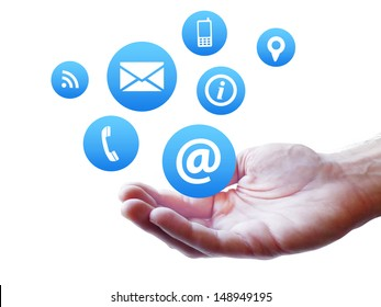 Website and Internet contact us page concept with icons fluttering on a man hand isolated on white background.