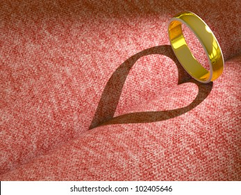 Wedding ring casting a heart on pink cloth